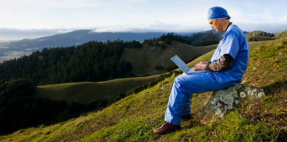 Healing Hospitals: Doctor on hillside with laptop