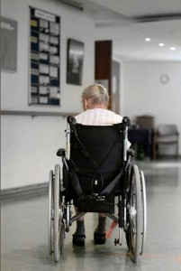 Senior woman patient in hospital hallway