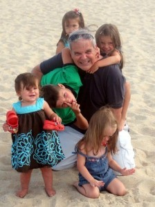 Nick Jacobs, FACHE at the beach with his grandchildren