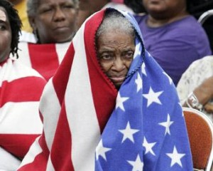 African-American Senior Woman Wrapped in US Flag